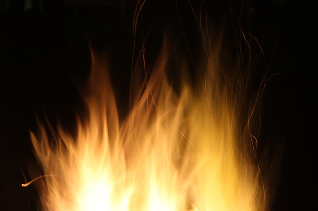 fire showing on a dark background