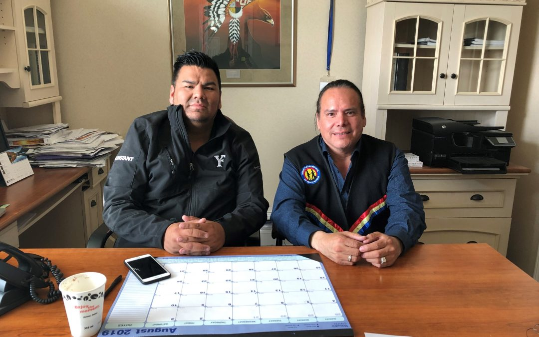 Chief Leroy Constant sits with Grand Chief Garrison Settee