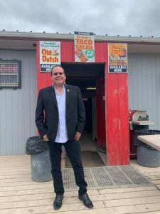Grand Chief Settee stands in front of a taco shop in Oxford House