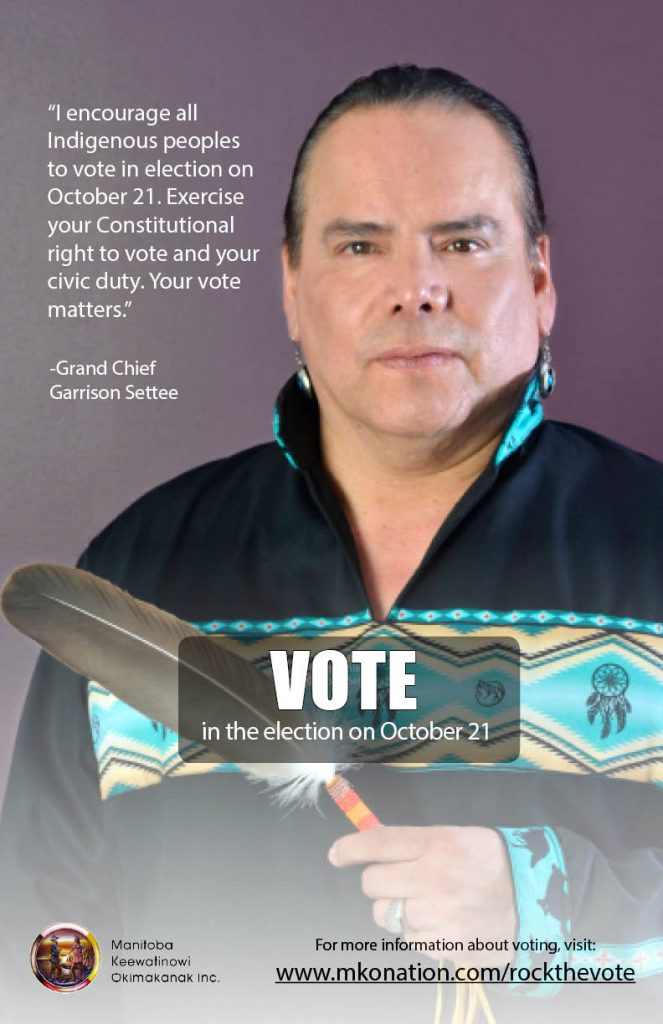 An image of Grand Chief Settee holding a feather