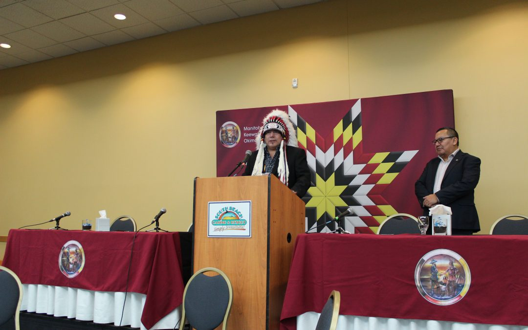 Grand Chief Garrison Settee speaking at a podium