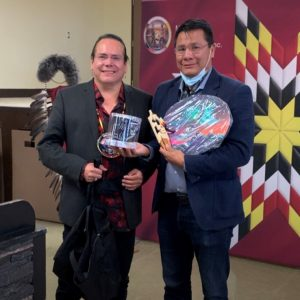 Grand Chief Settee presents a gift to Onekanew Sinclair of Opaskwayak Cree Nation