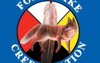 Photo of a fox on a medicine wheel and feather surrounded by the words Fox Lake Cree Nation