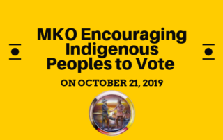 "A yellow banner with the words ""MKO Encouraging Indigenous Peoples to Vote on October 21, 2019"""